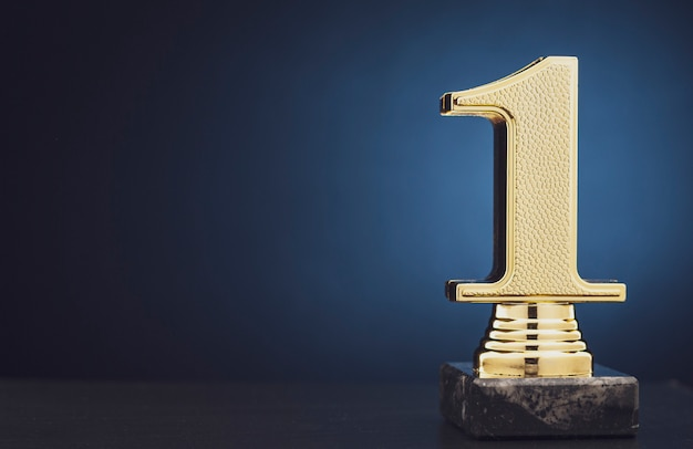 Champion or winner gold trophy over blue Premium Photo