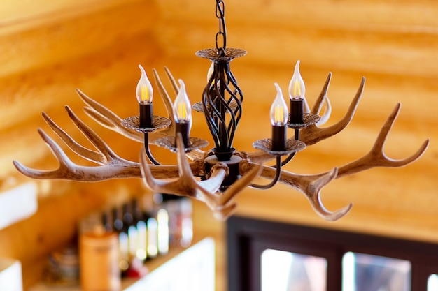 Chandelier with horns hanging in village house
