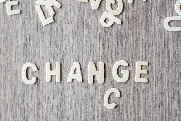 Change and chance word of wooden alphabet letters. business and idea concept Premium Photo