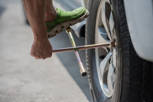 Changing a car tire, close up , car fixing and mainance service. Premium Photo