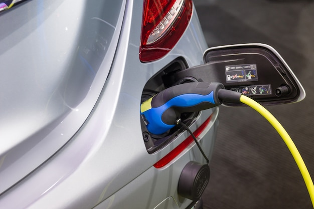 Charging an electric car battery Photo | Premium Download