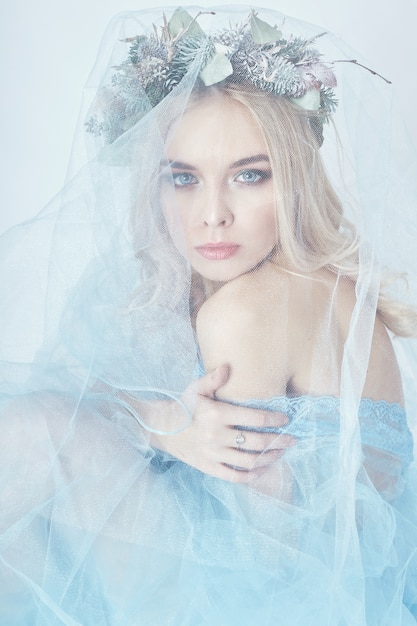 Charming fairy woman blue ethereal dress, wreath Premium Photo