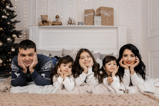 Charming family of nice couple with three charming children in b Free Photo