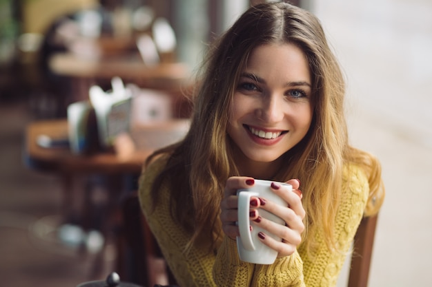 Charming girl drinking cappuccino Free Photo