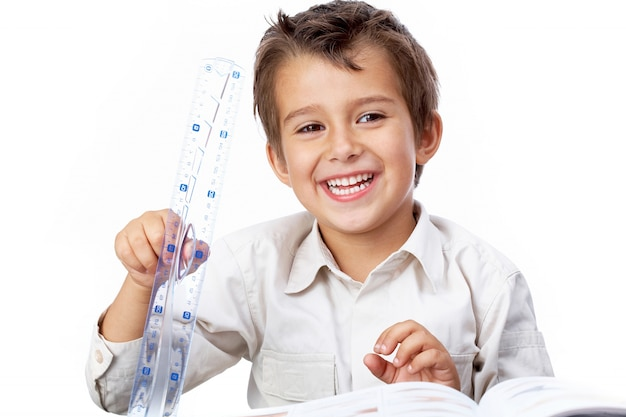 Charming little boy playing with the ruler Free Photo