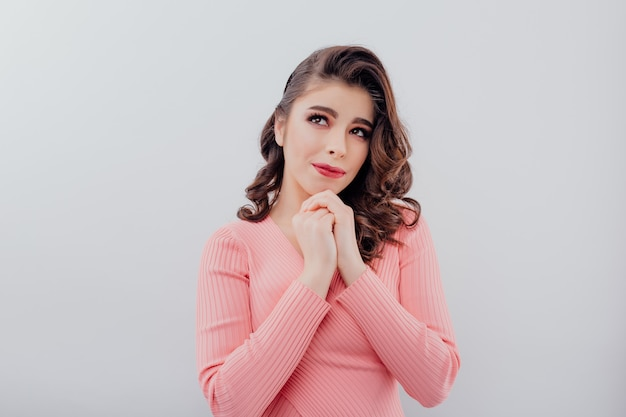 Charming pensive woman with hands near chin Premium Photo