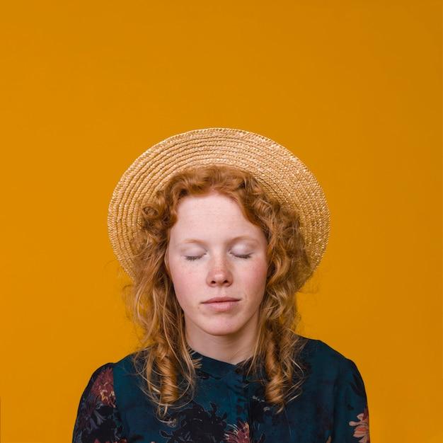 Charming redhead woman in studio Free Photo