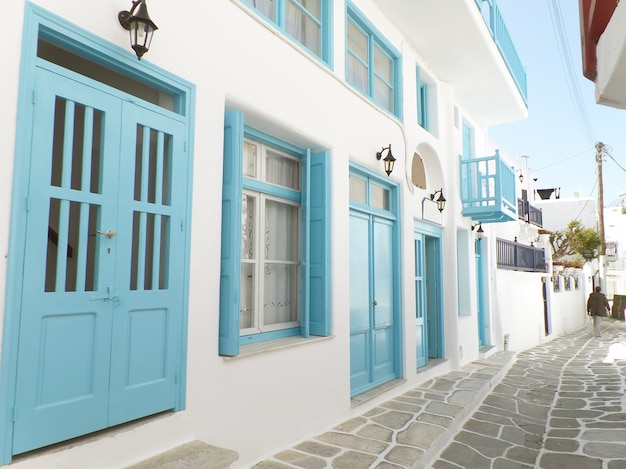 Charming small alley with white and blue colored buildings Premium Photo