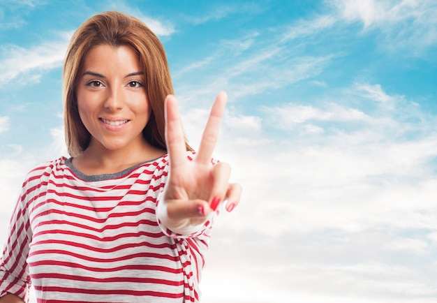 Charming woman showing peace sign Free Photo