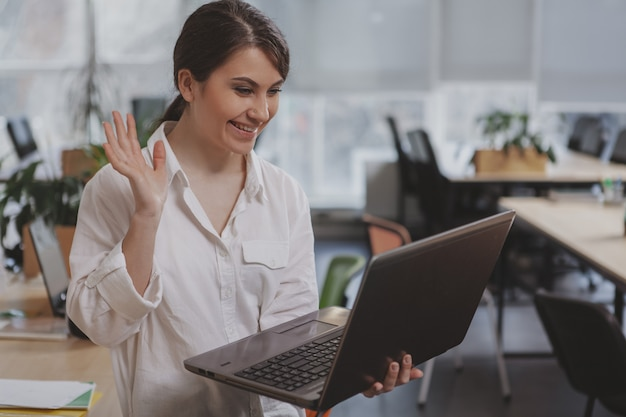 Charming young businesswoman working at her office Premium Photo