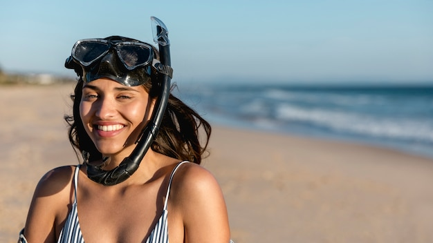 Charming young woman in snorkeling mask on beach Free Photo