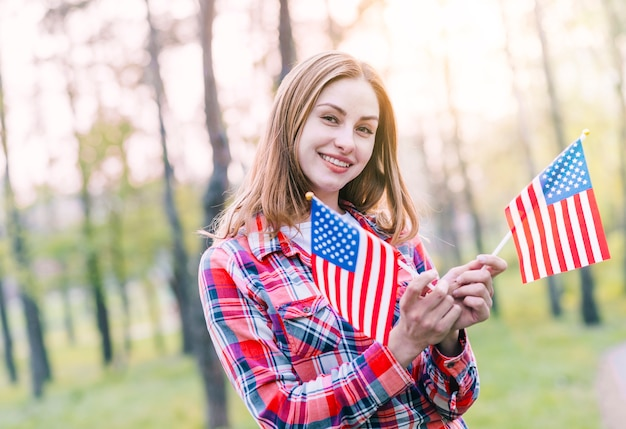 Charming young woman with american flags Free Photo