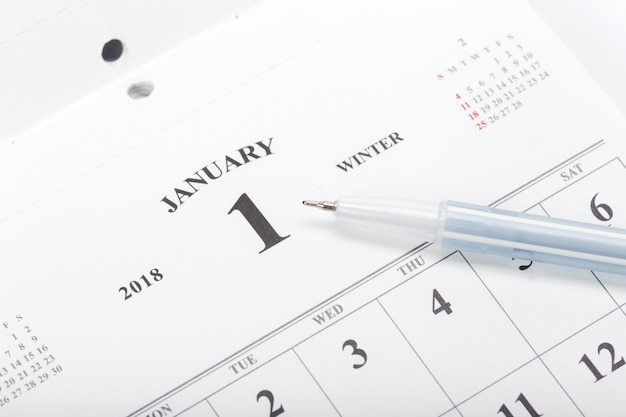 Check out the dates in a business calendar concept Premium Photo