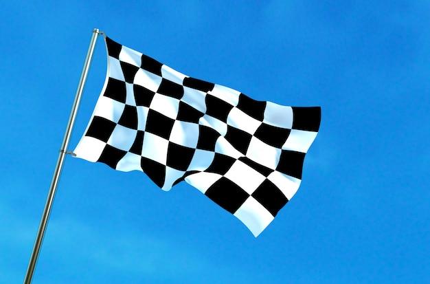 Checkered flag waving on the blue sky background Premium Photo