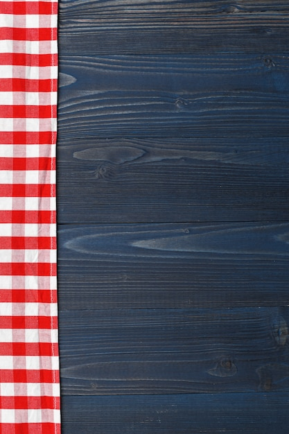 Checkered tablecloth on wooden table background Premium Photo