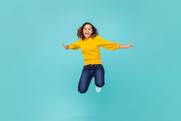 Cheerful african american woman  jumping Premium Photo