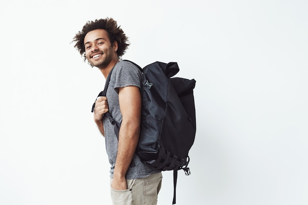 Cheerful african man with backpack smiling. Free Photo