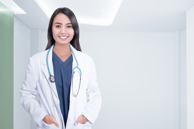 Cheerful asian doctor woman with stethoscope Premium Photo