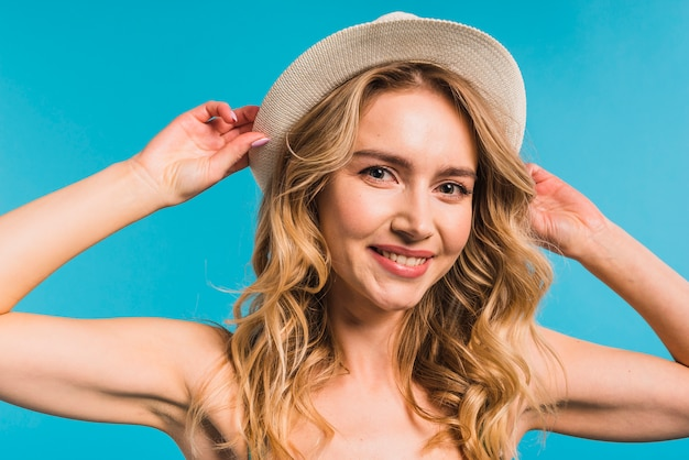 Cheerful attractive young woman in hat Free Photo