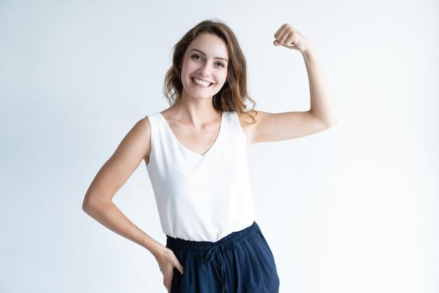 Cheerful beautiful woman pumping fist Free Photo