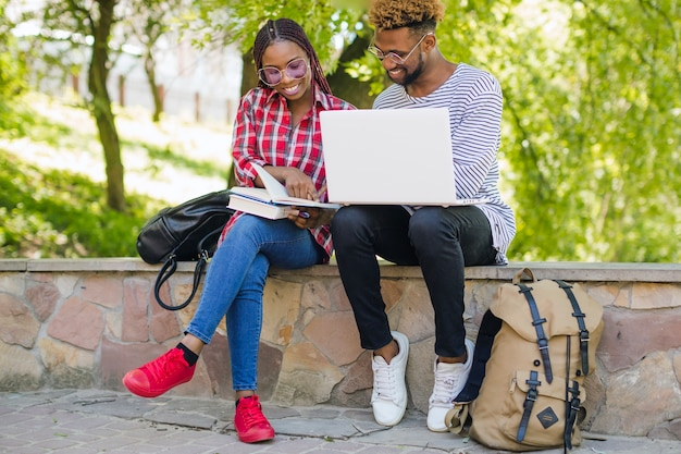 Cheerful black students studying together | Free Photo