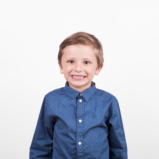 Cheerful boy in blue shirt Free Photo