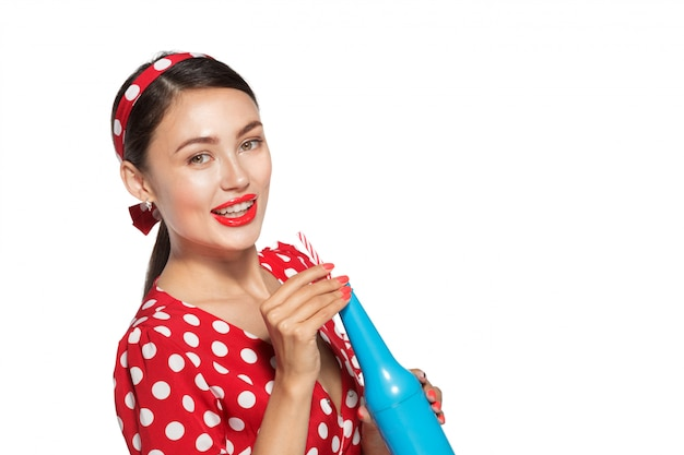 Cheerful brunette pin-up girl holding soft drink Premium Photo