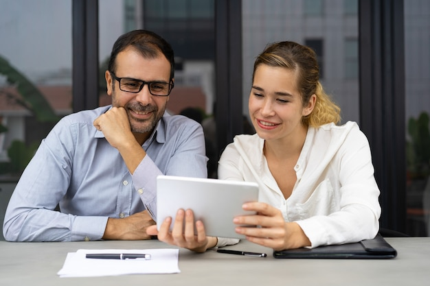 Cheerful business colleagues having video chat Free Photo