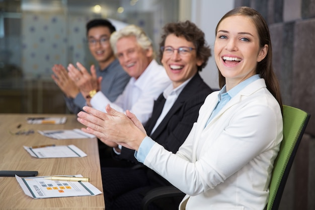 Cheerful business people clapping in boardroom Free Photo