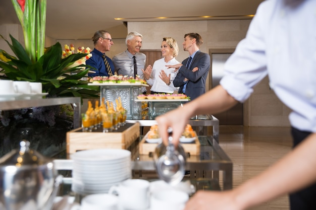 Cheerful Business People Talking in Buffet Free Photo