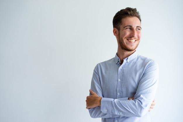 Cheerful businessman enjoying success Free Photo