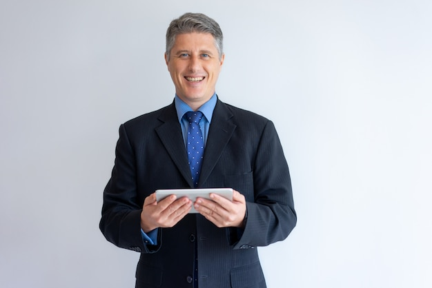 Cheerful businessman happy to set new mobile pc app Free Photo