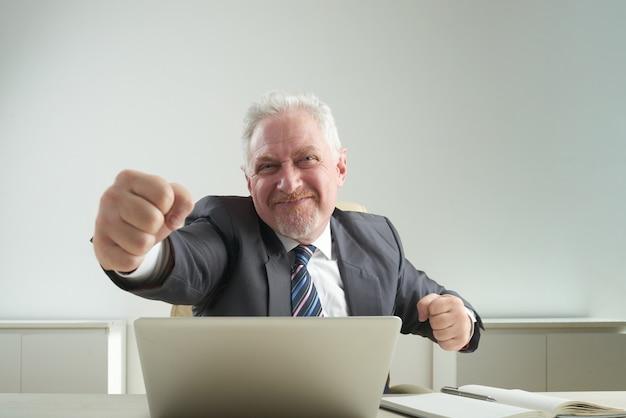 Cheerful businessman triumphing Free Photo