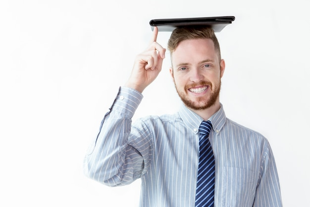 Cheerful businessman with leather folder on head Free Photo