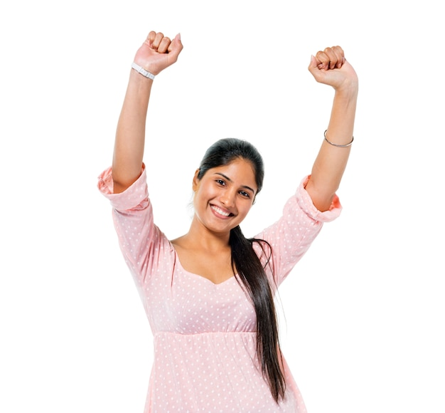Cheerful casual young woman celebrating Free Photo