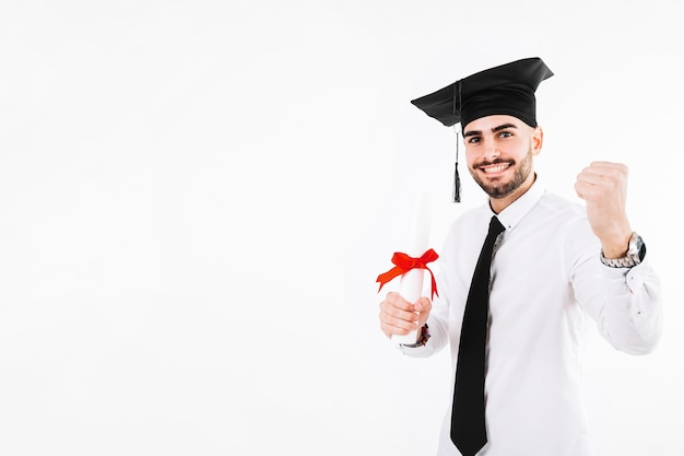 Cheerful celebrating young man with diploma Free Photo