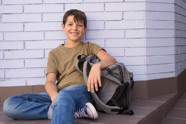 Cheerful child carrying his backpack Premium Photo