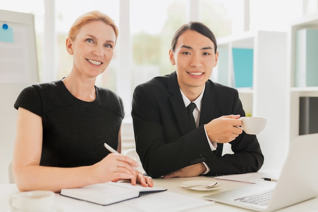 Cheerful colleagues having working meeting Free Photo