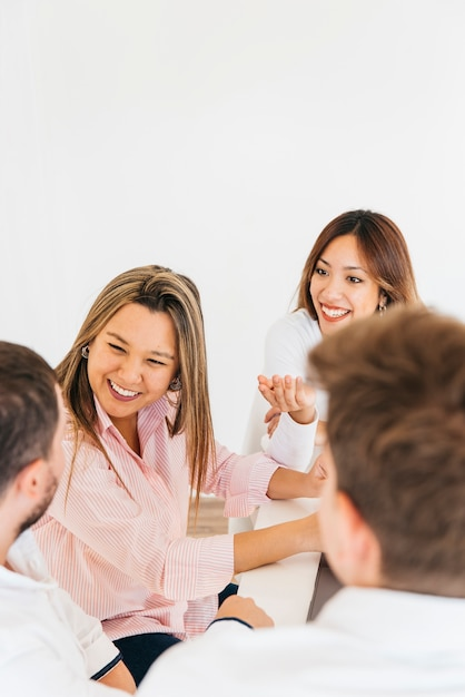 Cheerful colleagues laughing in office Free Photo