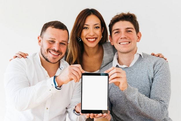 Cheerful colleagues presenting new tablet Free Photo