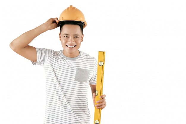 Cheerful construction worker Free Photo