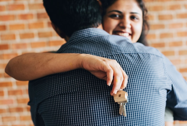 Cheerful couple with keys to their new home Free Photo