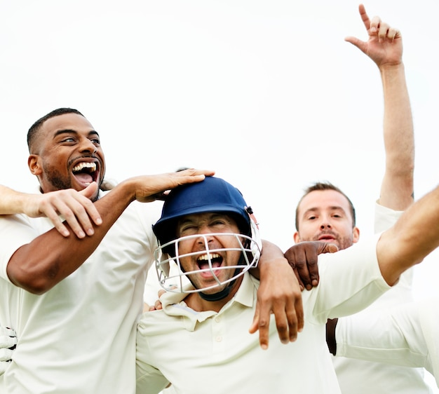 Cheerful cricketers celebrating their victory Premium Photo