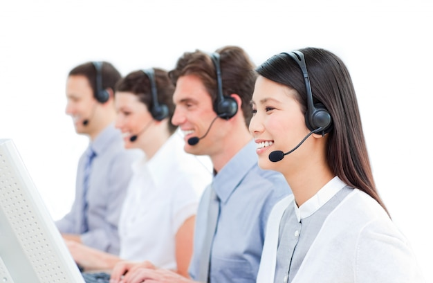 Cheerful customer service agents working in a call center Premium Photo