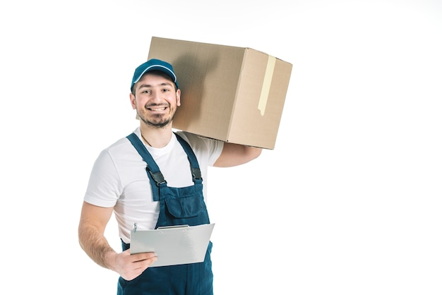 Cheerful deliveryman with parcel and clipboard Premium Photo