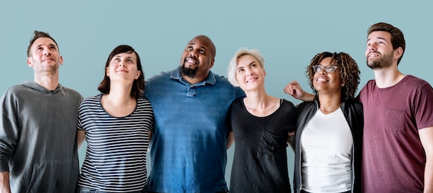 Cheerful diverse friends with arms around Free Photo