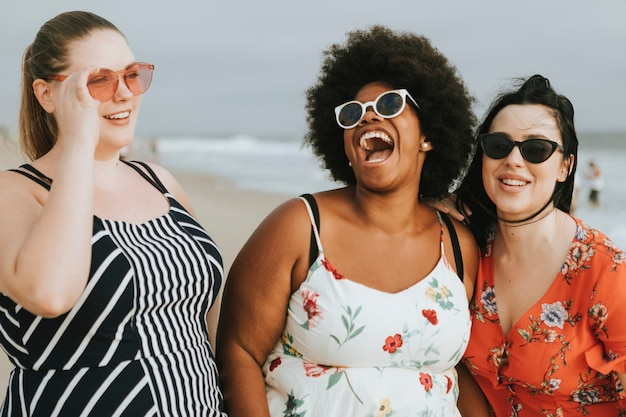 Cheerful diverse plus size women at the beach Free Photo