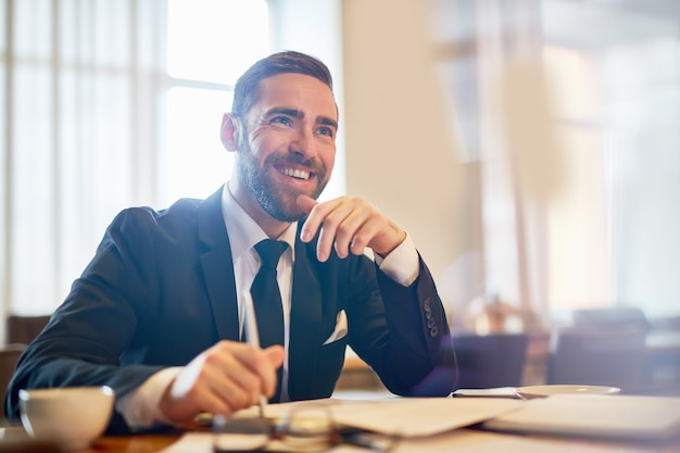 Cheerful entrepreneur at workplace Free Photo