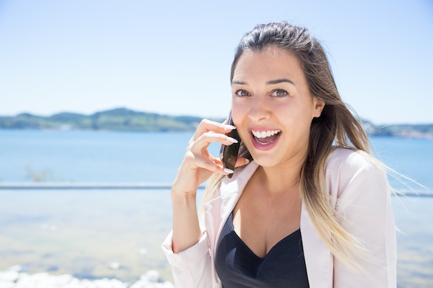 Cheerful excited lady happy to get great news Free Photo