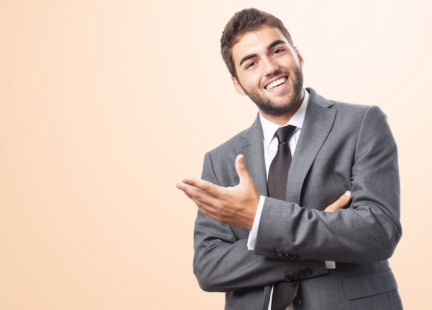 Cheerful executive over pink background Free Photo
